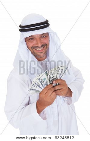 Portrait Of Mature Arab Man Holding Dollars
