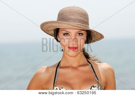Attractive Woman Smiling With A Sun Hat On A Tropical Beach