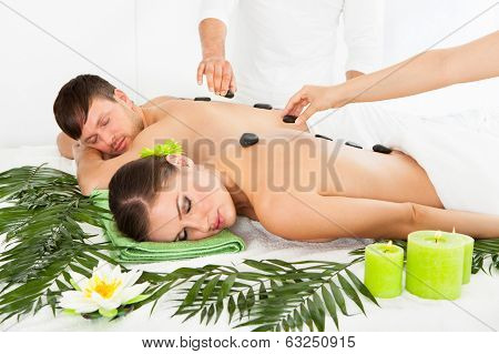 Couple Having A Hot Stone Massage
