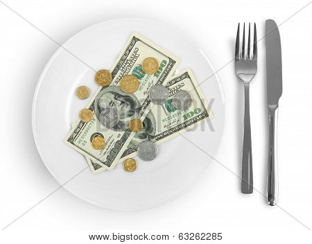 money on a plate isolated on a white background