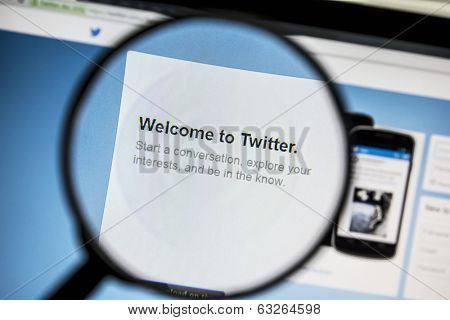 Ostersund, Sweden - April 13, 2014: Twitter website under a magnifying glass. Twitter is a free social networking and microblogging service