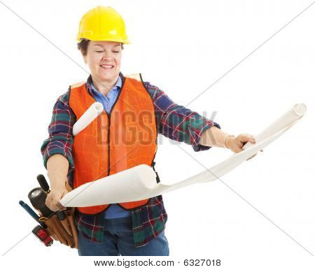 Female Contractor Examines Blueprint
