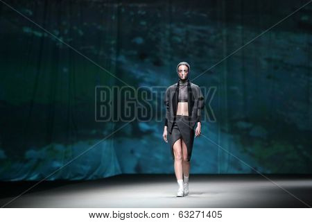 Fashion model wears clothes made by Mario Vijackic on