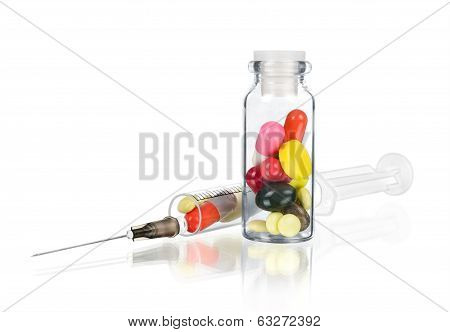 medical ampoule with pills and syringe isolated on white