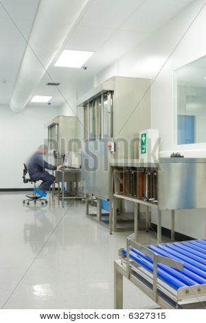 Technician At Work In Clean Room Interior