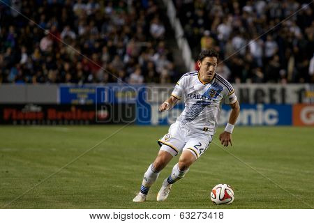 CARSON, CA - APRIL 12: Los Angeles Galaxy M Stefan Ishizaki #24 during the MLS game between the Los Angeles Galaxy & the Vancouver Whitecaps on April 12th 2014 at the StubHub Center.