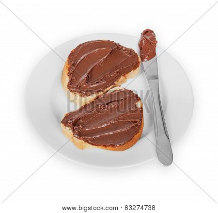 Baguette Slices Spread With Nut-choco Paste On Plate, Isolated On White