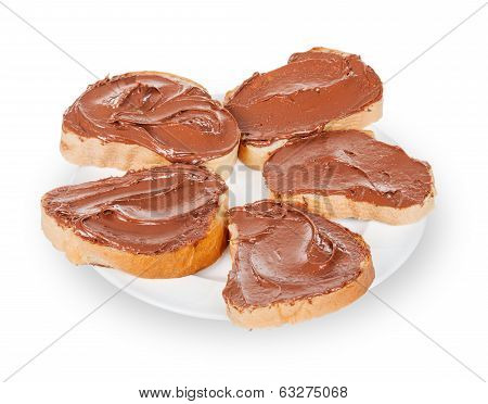 baguette slice spread with nut-choco paste, isolated on white