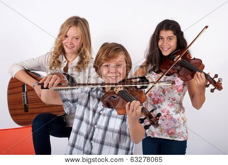 Two Girls And A Boy Playing Instruments