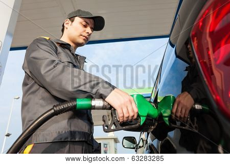 Gas station attendant at work