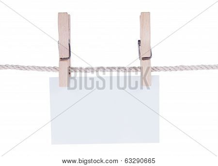 Paper or cardboard background, with clothes pegs, isolated on white background