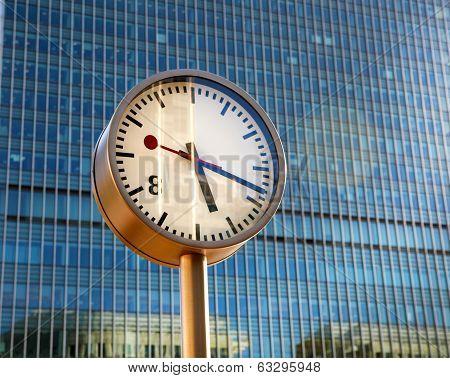 LONDON, CANARY WHARF, UK - APRIL 13, 2014 - Clock of the Canary Wharf