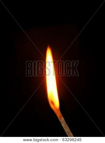 Ignition of a match, with smoke on dark background