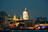 St Pauls Cathedral over Thames River at night in London.