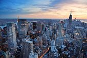 image of skyscrapers  - New York City skyline with urban skyscrapers at sunset - JPG