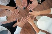Business people showing hands together as a sign of unity