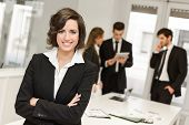 stock photo of leader  - Image of businesswoman leader looking at camera in working environment - JPG