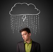 Thoughtful young businessman with thundercloud above his head