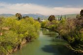 stock photo of israel people  - Beautiful landscape of the mountains of Galillee and Golan Heights via Jordan River - JPG