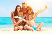 stock photo of joy  - Happy Family Having Fun at the Beach - JPG