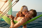 Young couple relaxing on the yacht in the sea at sunny day