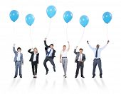 Playful Multiethnic Business People Holding Balloons