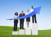 Business People Outdoors Holding Arrows that Shows Progress