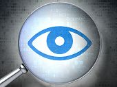 Security concept: Eye with optical glass on digital background