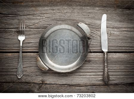 Old frying pan on wooden background