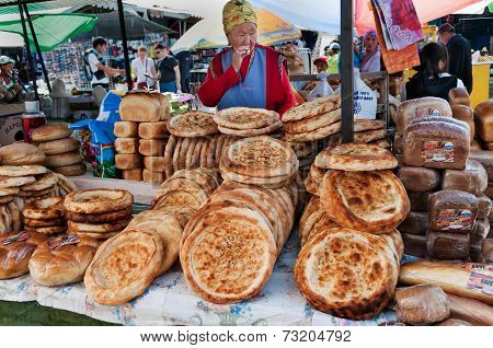 Kirghiz Bread Tokoch On Sunday Market In Bosteri. Issyk-kul. Kyrgyzstan.