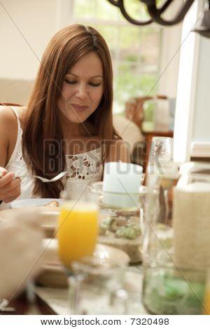 Brunette Eating Lunch