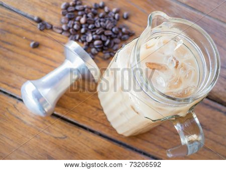 Iced Milk Coffee On Wooden Table