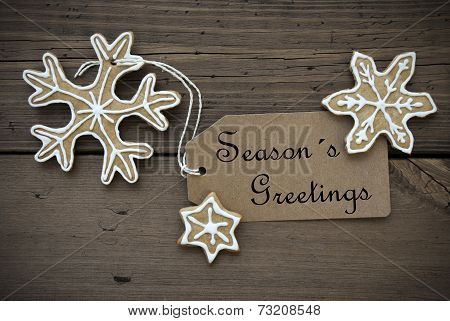 Season's Greetings On A Label With Ginger Bread Cookies