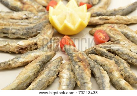 fried anchovies isolated on a white background