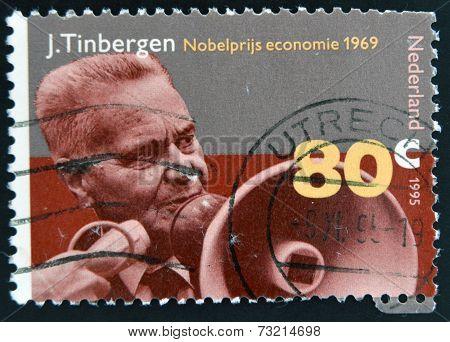 NETHERLANDS - CIRCA 1995: Stamp printed in Holland shows Jan Tinbergen Dutch economist circa 1995.