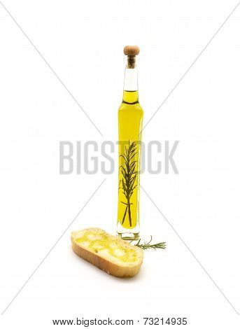 oil flavored with rosemary branch and slice of bread