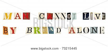 The proverb Man Cannot Live By Bread Alone formed with magazine letters on white background