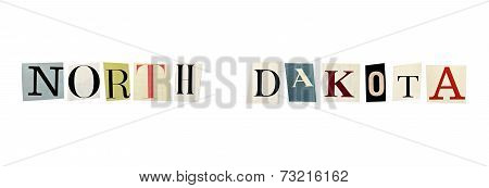 North Dakota word formed with magazine letters on a white background