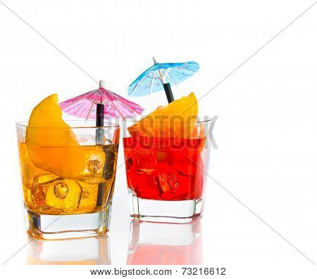 Two Cocktail With Orange Slice And Umbrella On Top Isolated On White Background