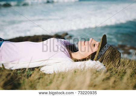 Funky Woman Resting And Relaxing Towards The Sea