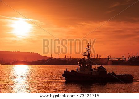 Tug Is Underway On Black Sea At Sunset, Varna Harbor, Bulgaria
