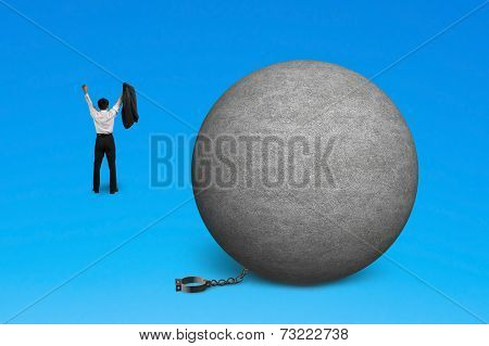 Cheering Man Free From Concrete Ball Shackle