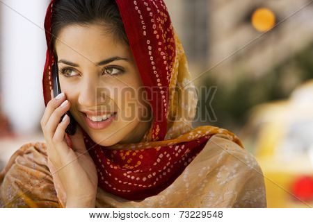 Middle Eastern woman talking on cell phone