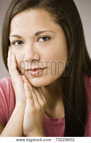 Asian girl resting chin on hands