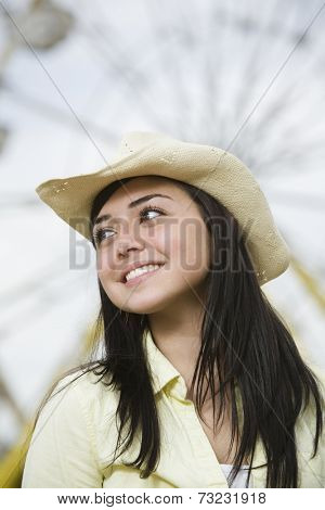 Mixed Race teenaged girl wearing cowboy hat