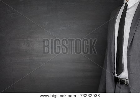 Businessman front of Blackboard