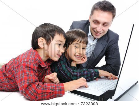 Happy fatherhood and childhood with laptop