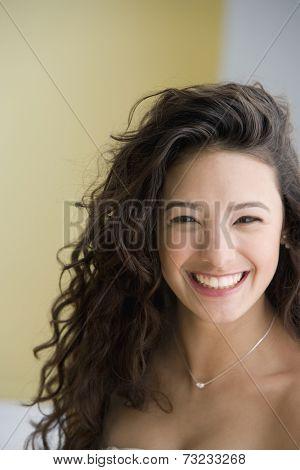Close up of Hispanic teenaged girl smiling
