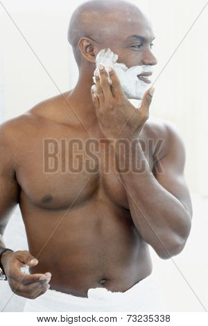 African American man applying shaving cream
