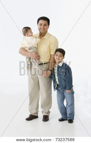 Portrait of Hispanic father and children